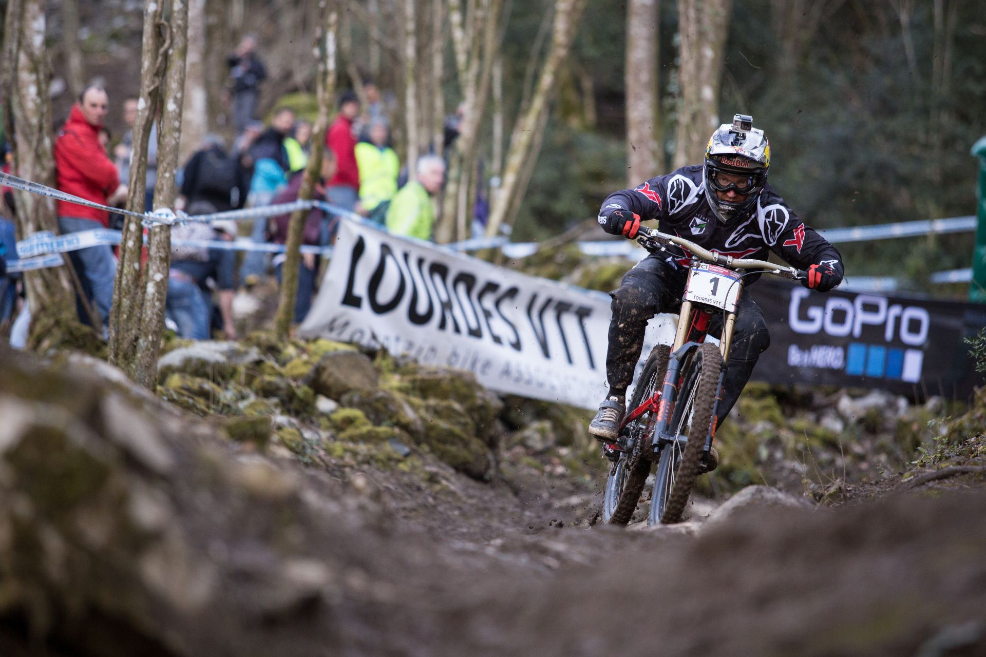 Aaron Gwin racing downhill in Lourdes